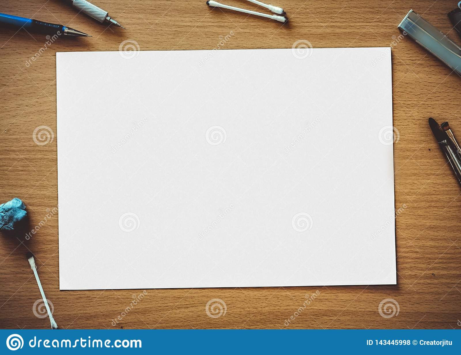 A Rectangular Chart Put On A Brown Coloured Wooden Table And A