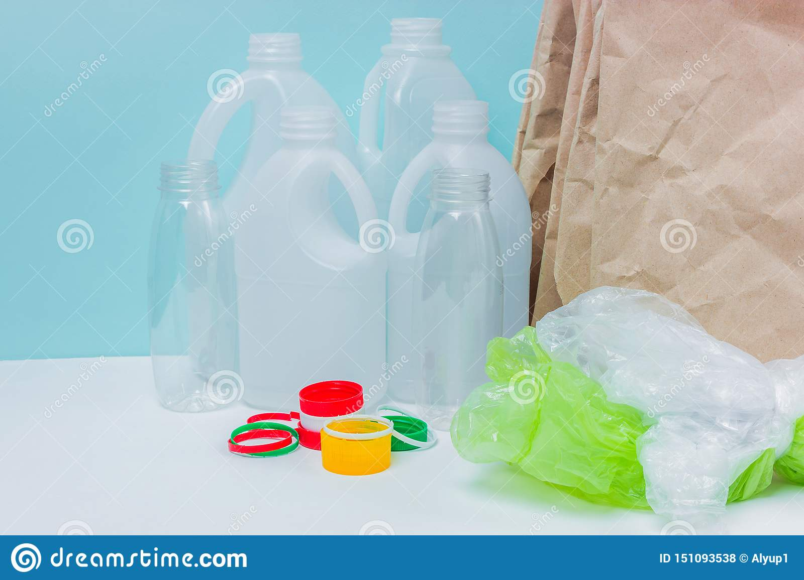 Recyclable materials on blue background.