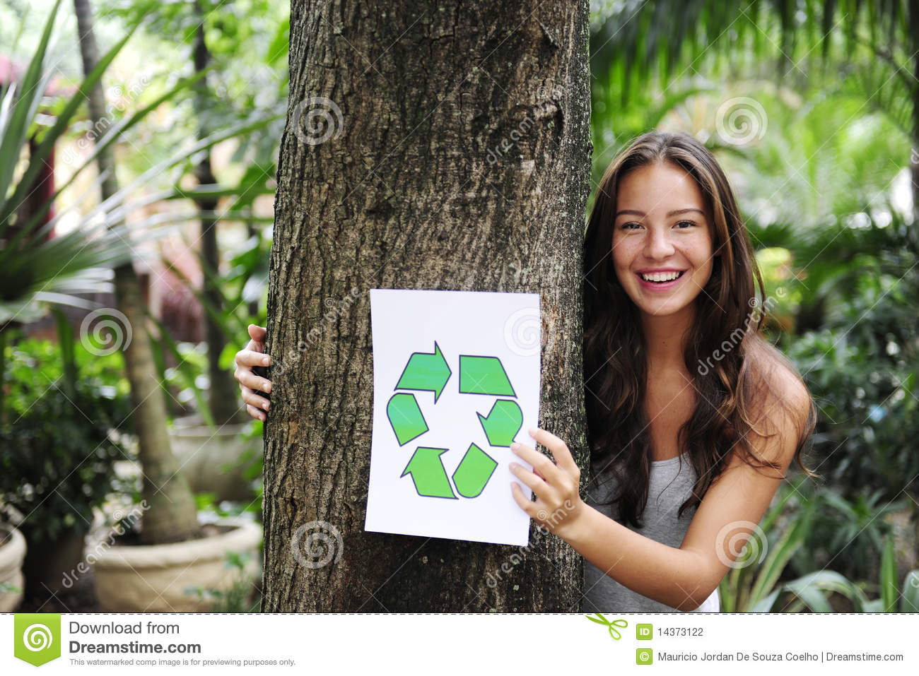 Nature Images 2mb: Recycling: Woman In Forest With Recycle Sign Stock