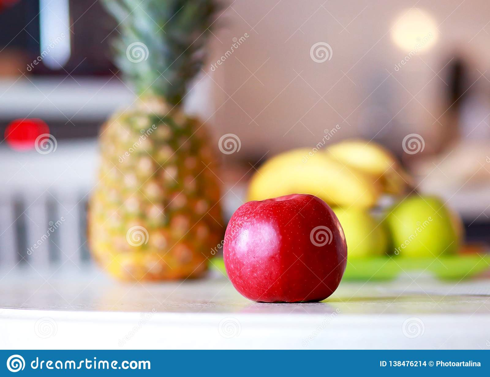 red apple and exotic fruits are on the table