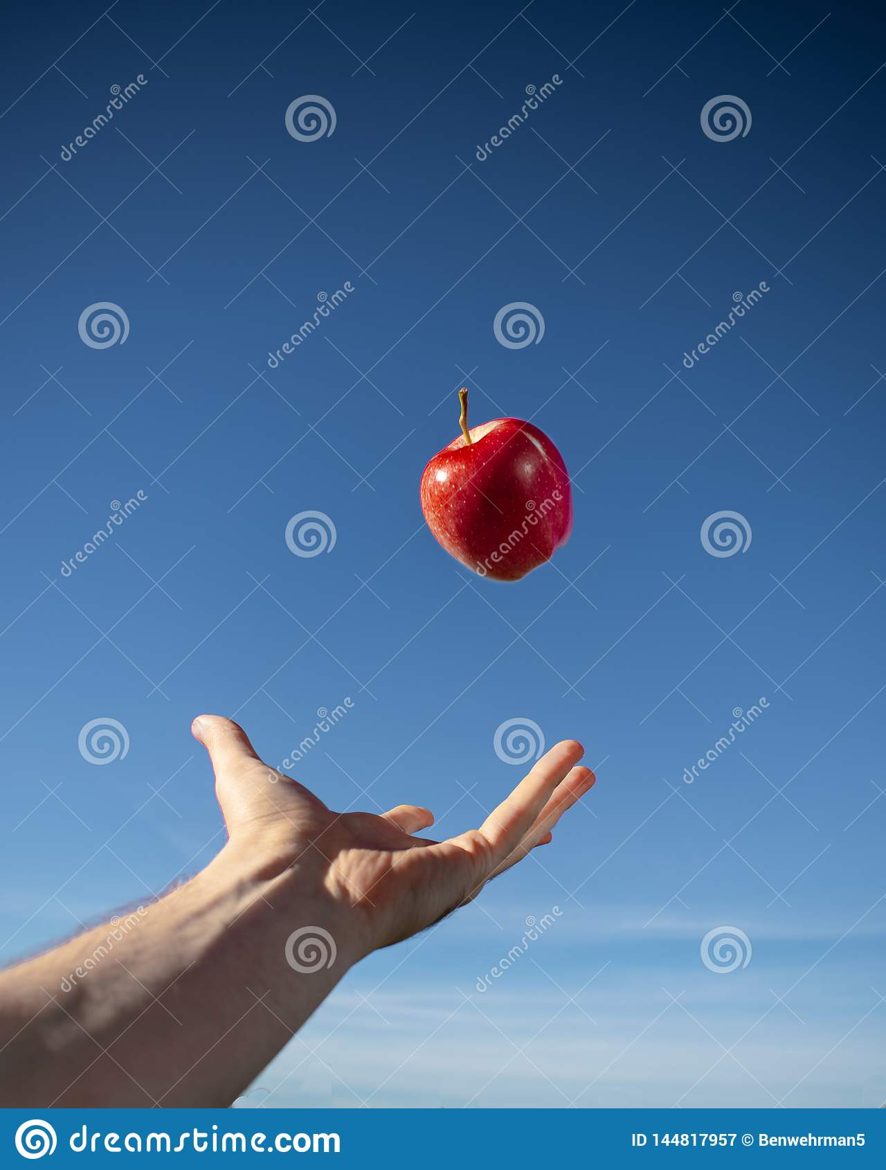 Red Apple Floating in the Air