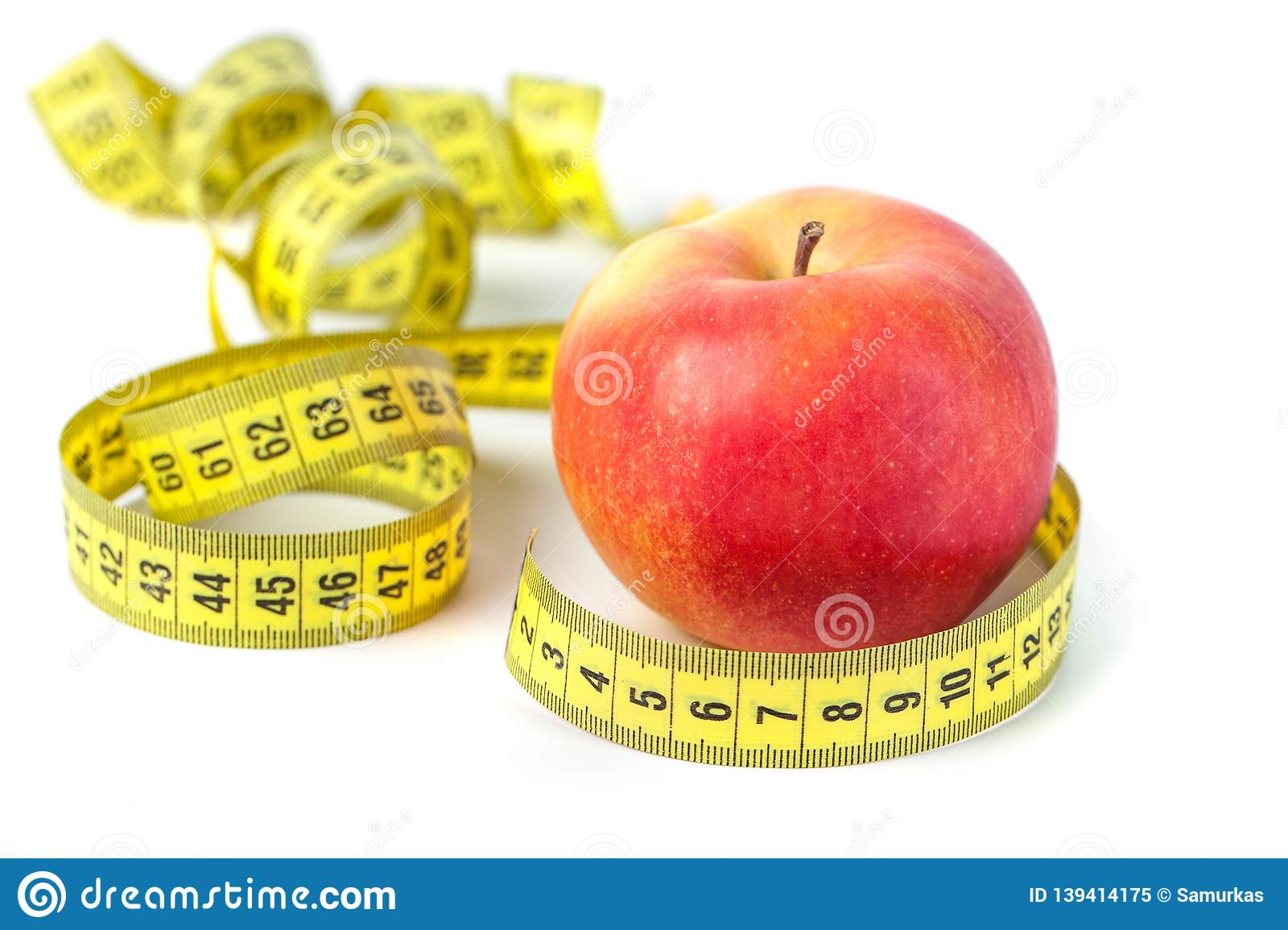 Red apple with measure tape on white background, healthy diet