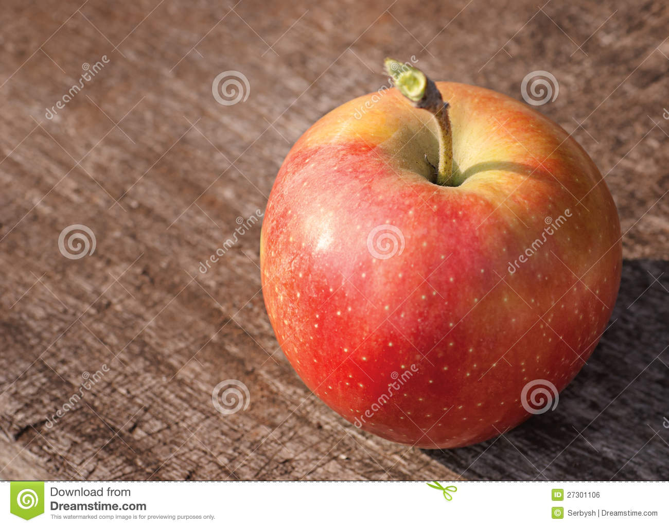Red Apple On Old Wooden Table Royalty Free Stock Image