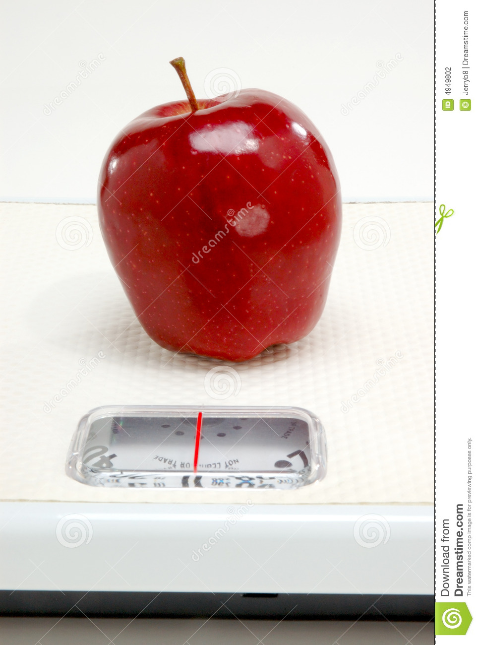 Red apple on scale
