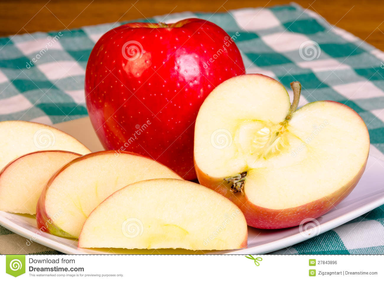 Red Apple Sliced On Plate Royalty Free Stock Image - Image: 27843896