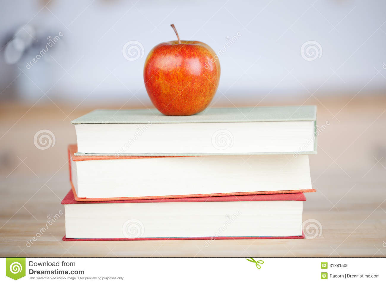 Red Apple On Stacked Books On Table Royalty Free Stock