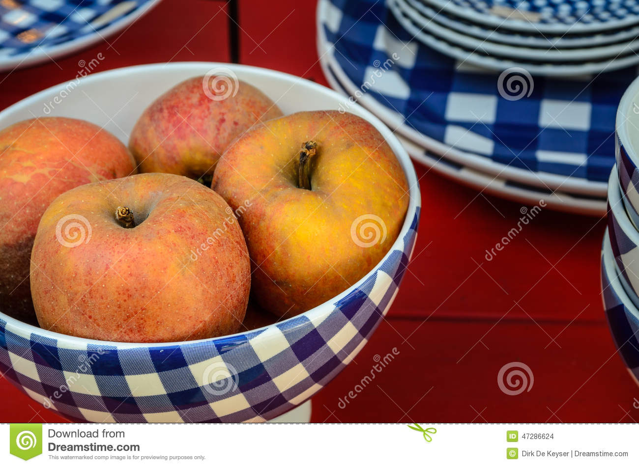 Red apples in blue and white bowl