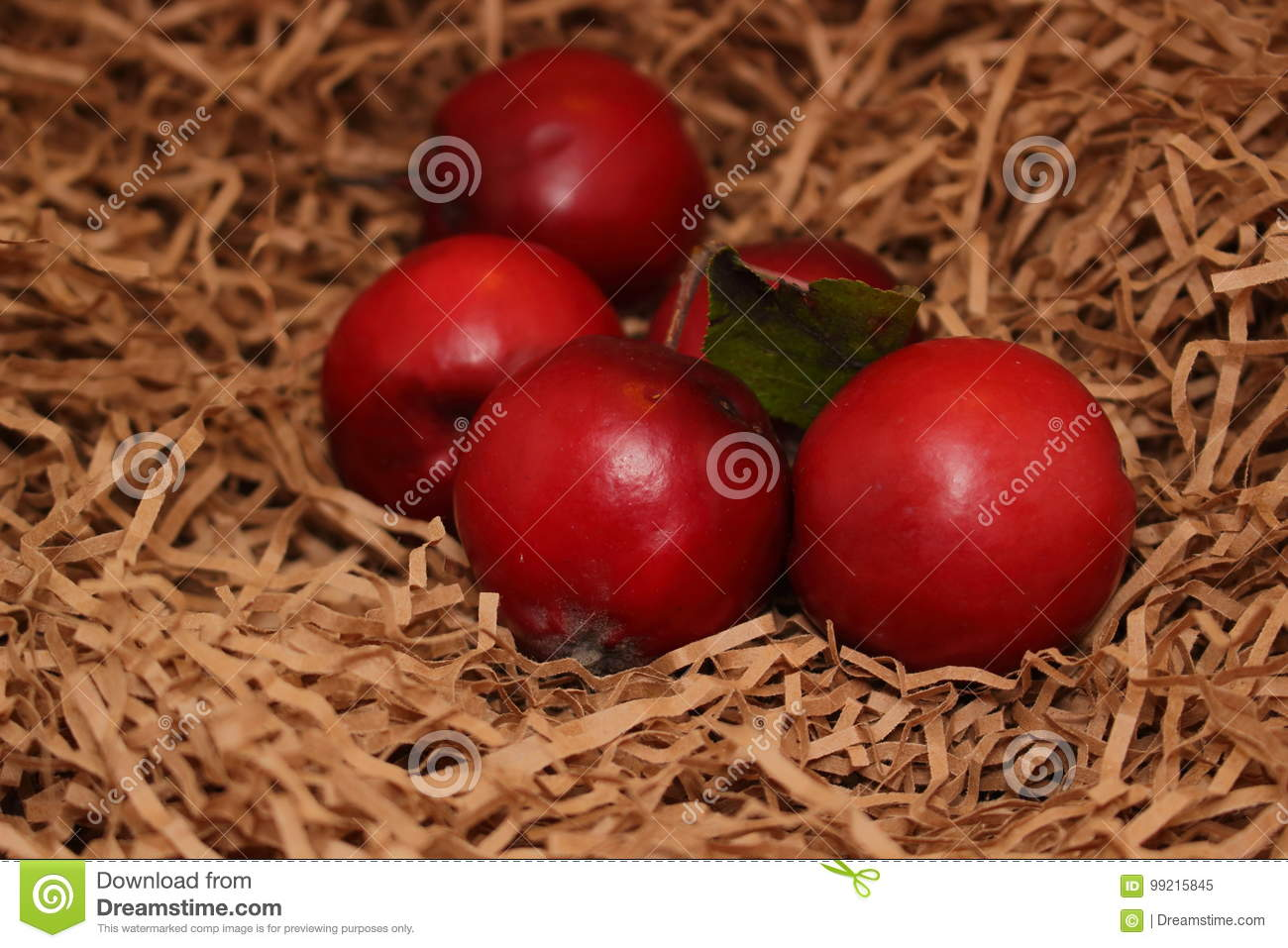 Red apples on paper