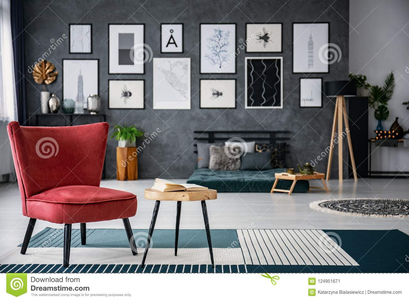 Delightful Download Red Armchair Next To Table On Carpet In Dark Grey Living Room  Interior With Gallery