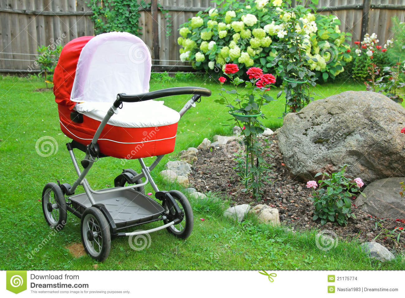 Red baby stroller on nature in park