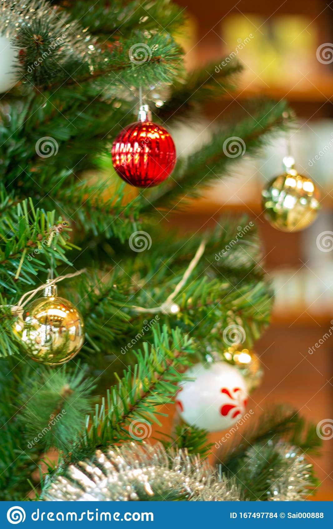 Red Ball On A Christmas Tree With A Garland On The Background Of A Wooden Wall Stock Photo Image Of Fruit Chocolate 167497784