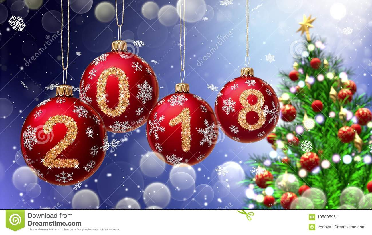 Red balls with numbers 2018 hanging on the background of a blue bokeh and a rotating Christmas tree