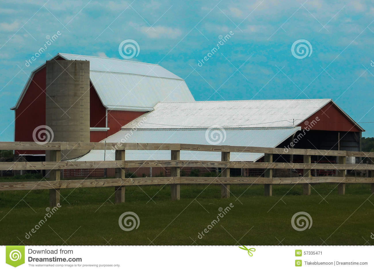 Cow on green pasture with red barn with grain silo royalty free stock - Royalty Free Stock Photo Red Barn Silo And Fence Stock Photo