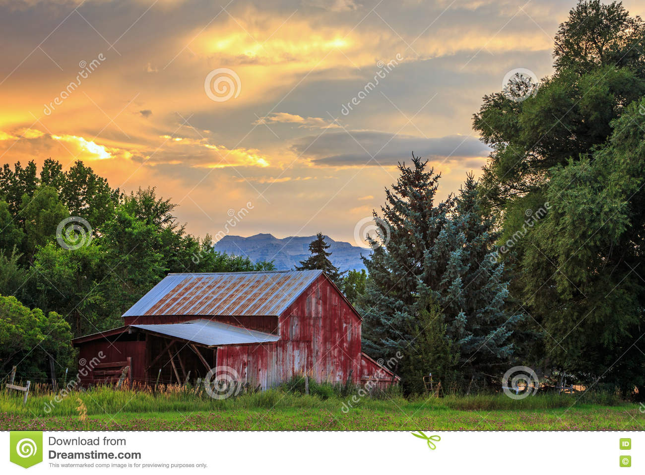 red barn sunset in rural utah usa stock image