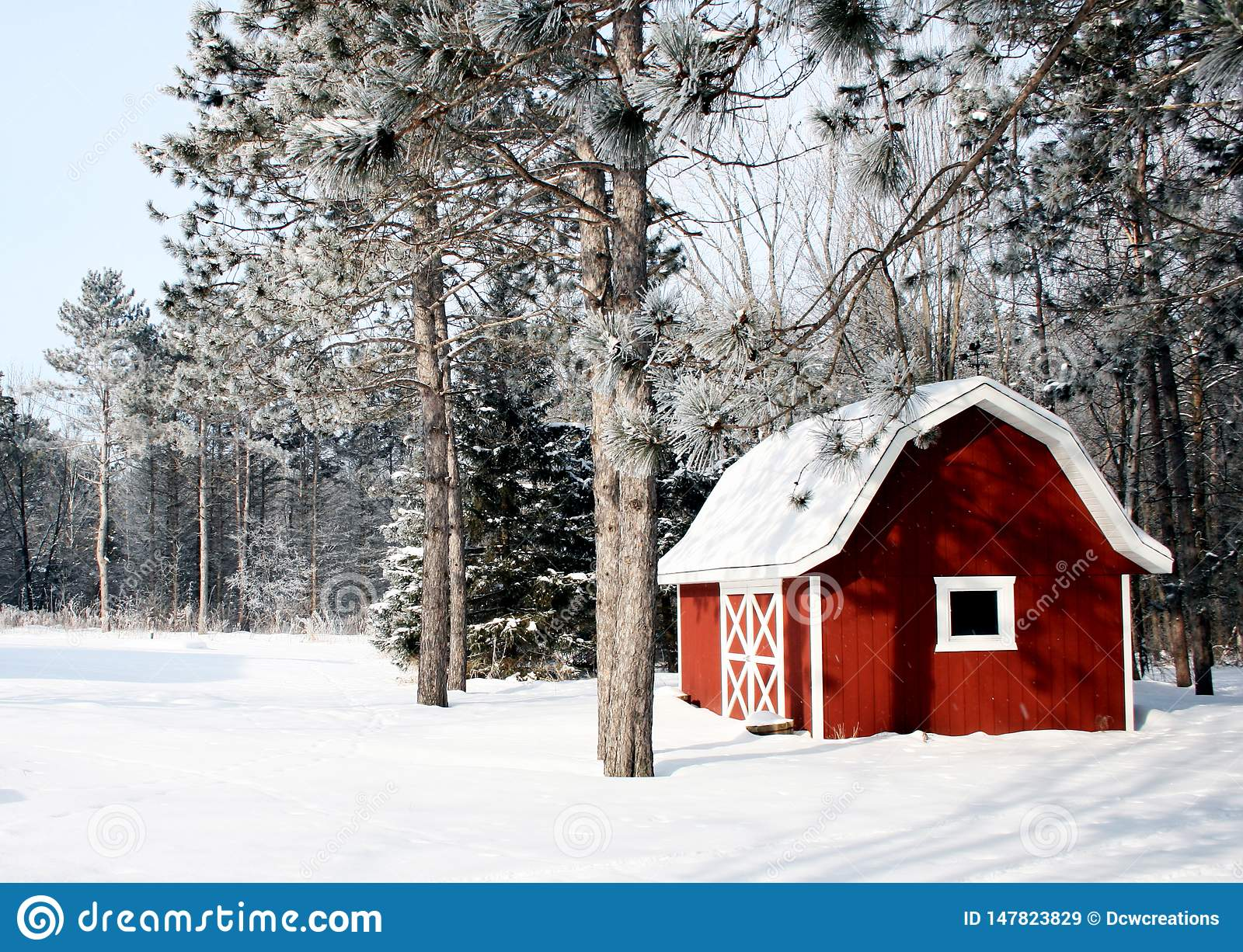 Red barn on a winter background