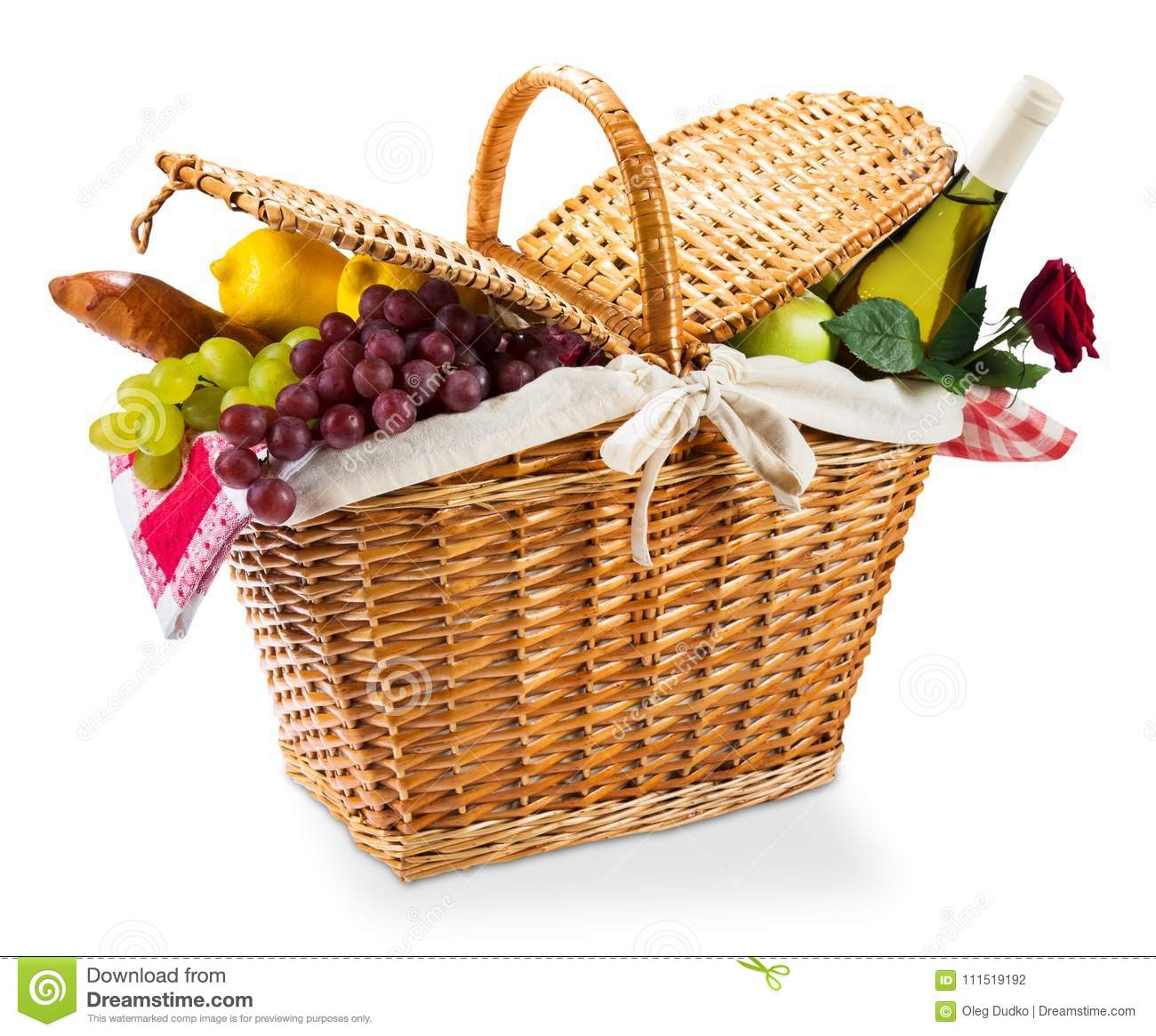Wicker picnic basket with a red gingham cloth on a
