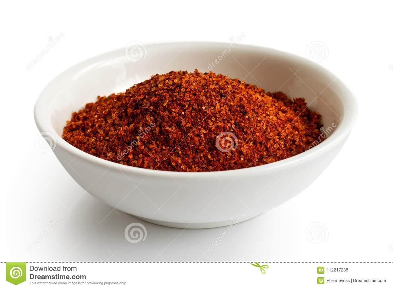 Red bbq spice mix in white ceramic bowl.