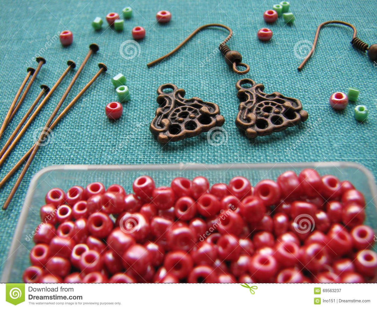 red beads and pieces for making earrings handmade jewelry stock  - red beads and pieces for making earrings handmade jewelry stock photo