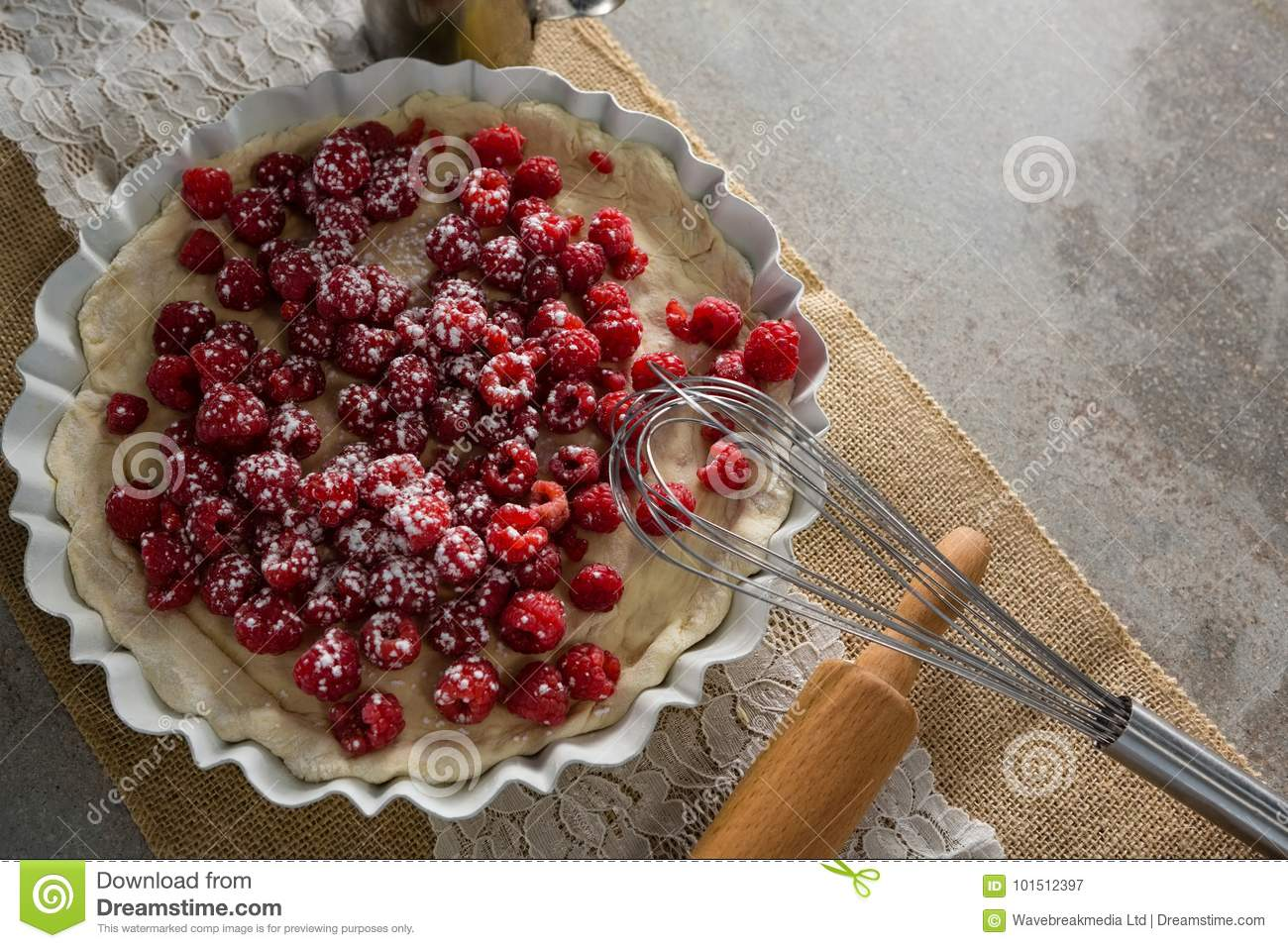 Red berries on tart with whisker and rolling pin
