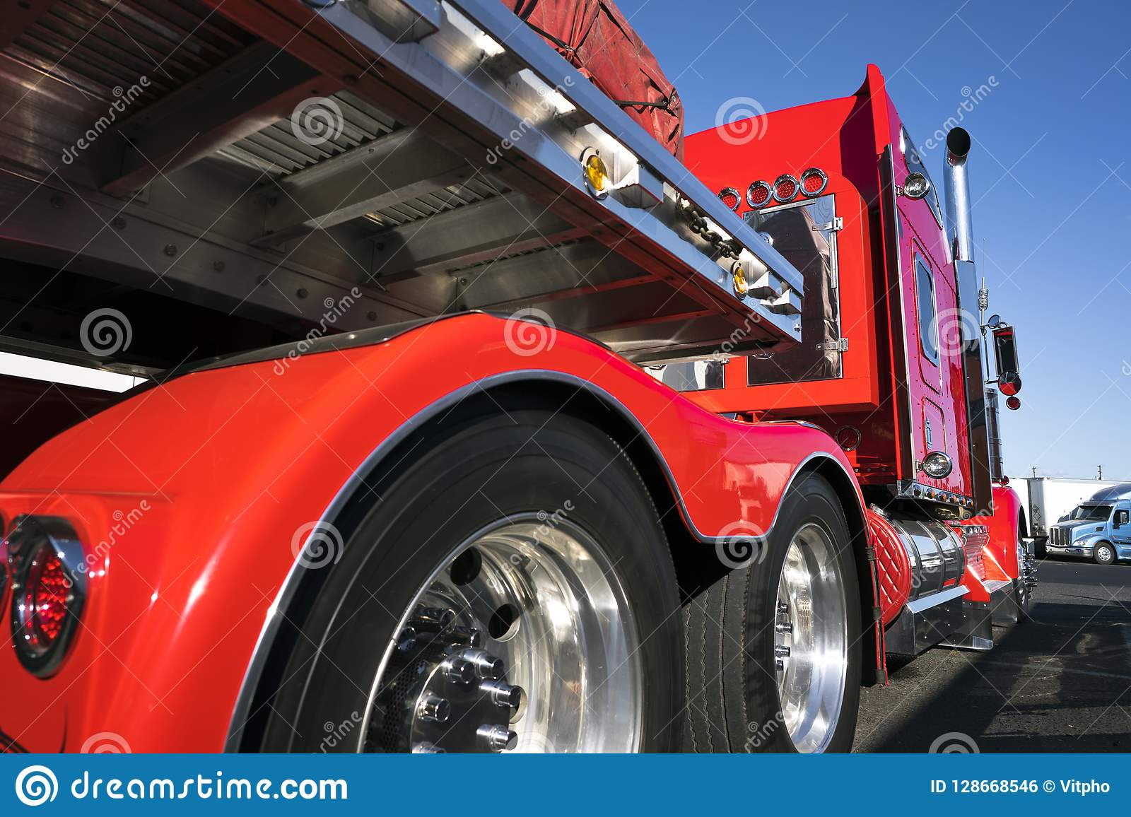 Red Big Rig Semi Truck With Alumnum Flat Bed Semi Trailer Standing For Rest On Truck Stop Stock Photo Image Of Conveyance Carrying 128668546