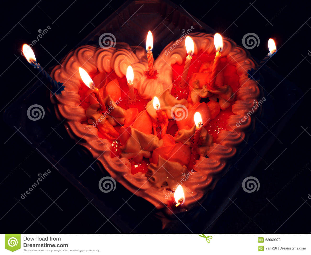 Red Birthday Cake In The Form Of Heart With Candles