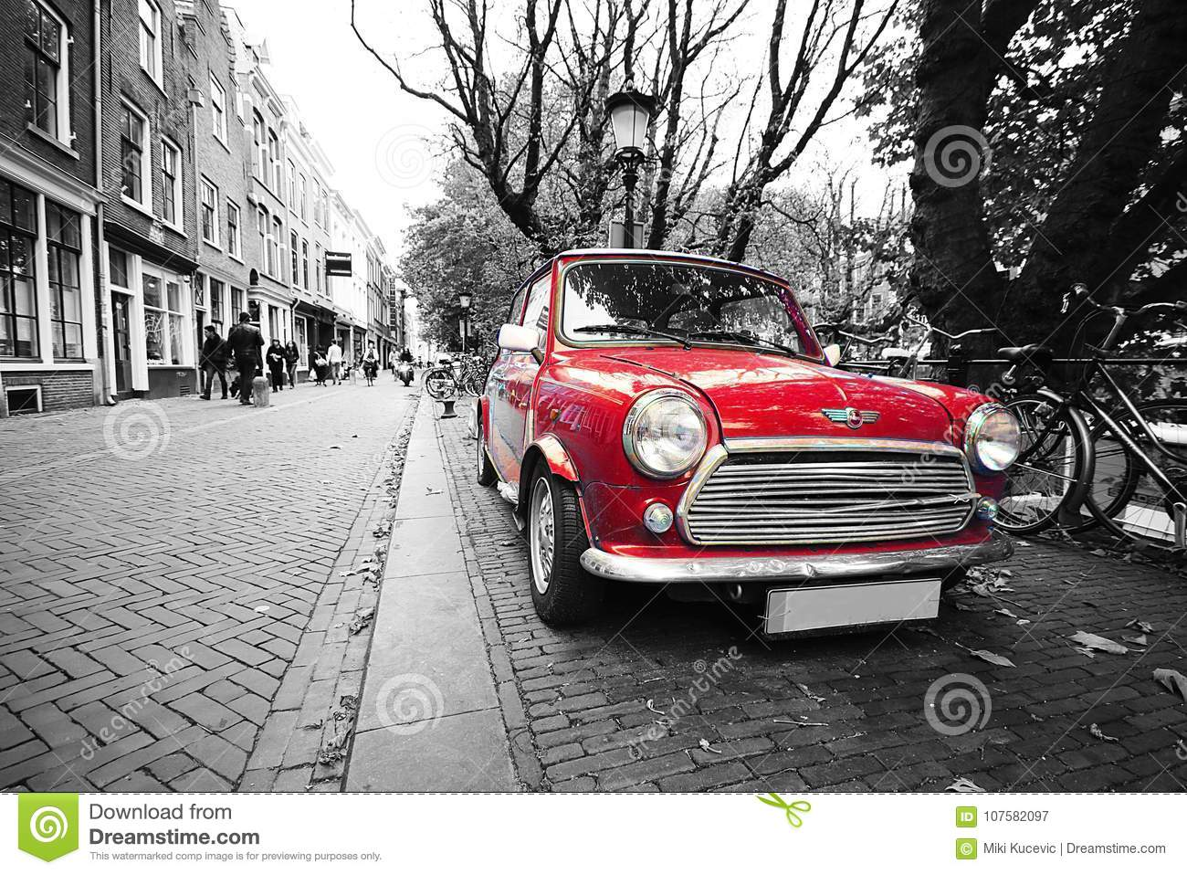 Red black and white classic mini cooper car in holland postcard