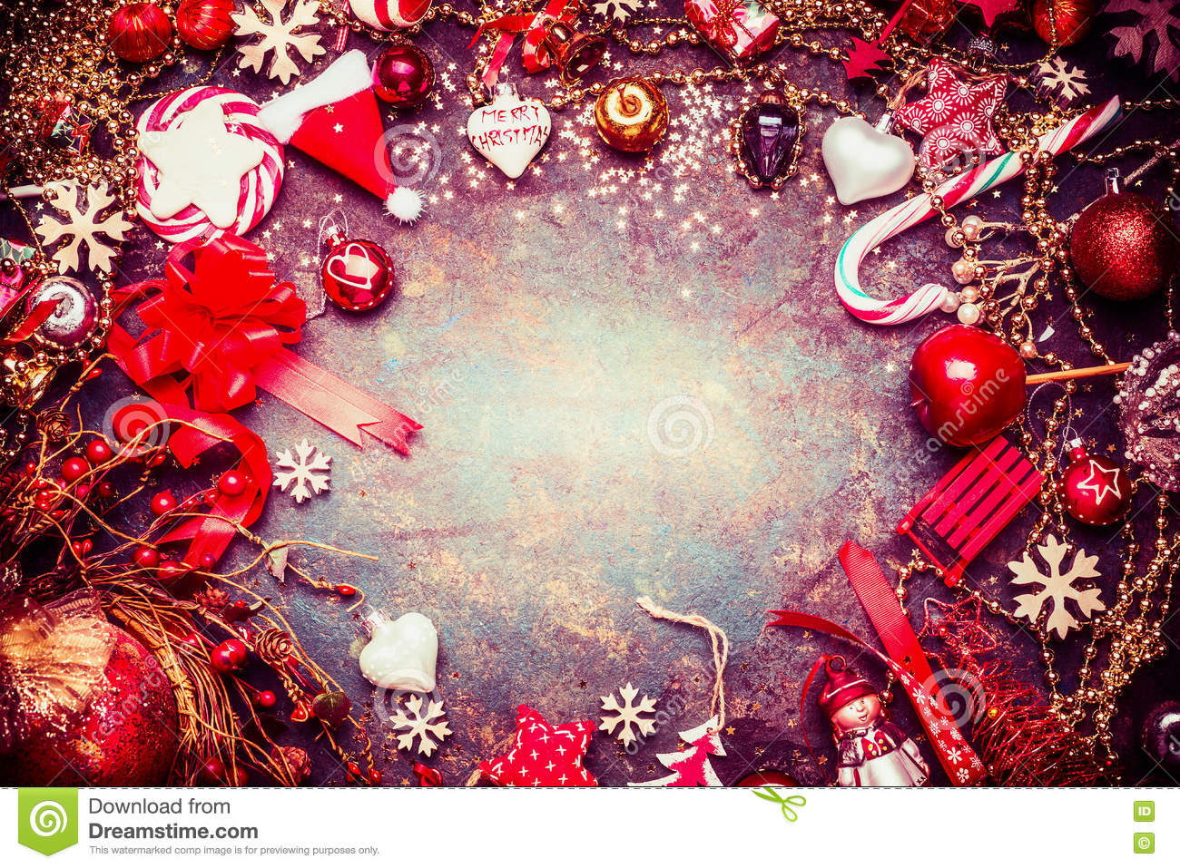 Red blue Christmas frame with various vintage holiday decorations and candy on rustic background