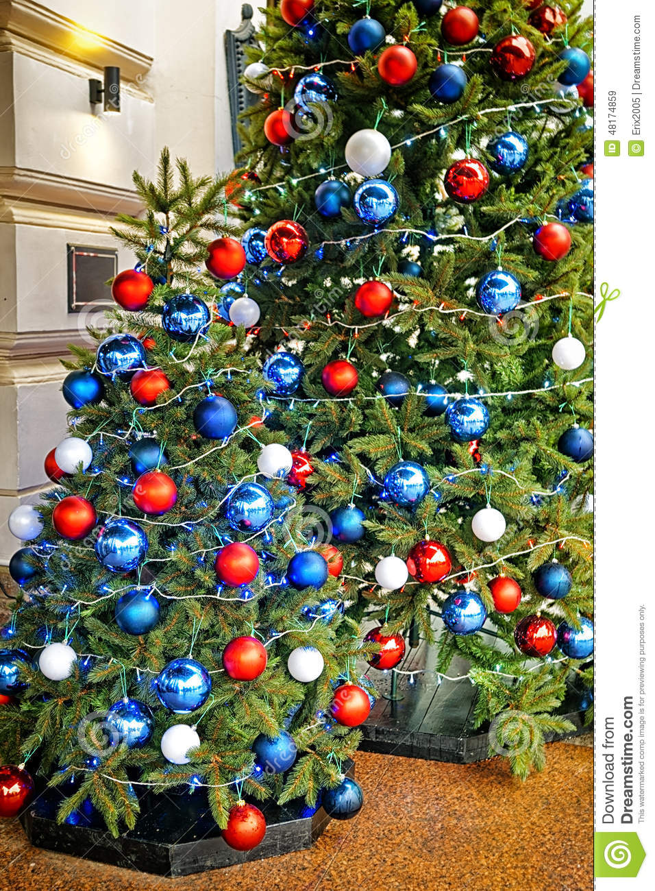 Red Blue And White Decorating Balls On The Christmas Tree