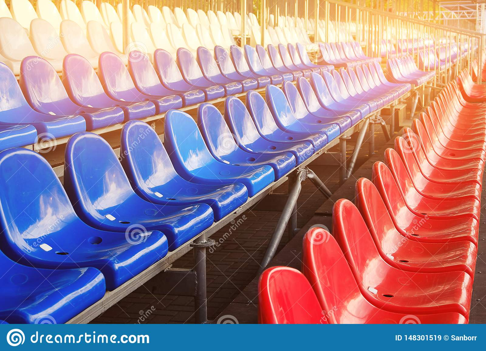 Red, blue and white sports stadium seats. Empty stands, no spectators at the competitions