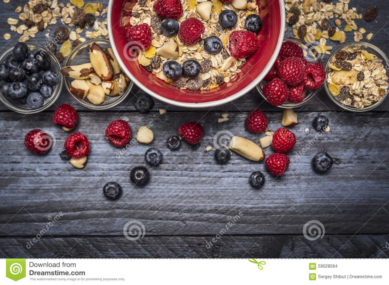 Download Red Bowl With Muesli, Nuts And Fresh Berries On Blue Rustic Background, Top View, Border Stock Photo - Image of berries, crunchy: 59028584