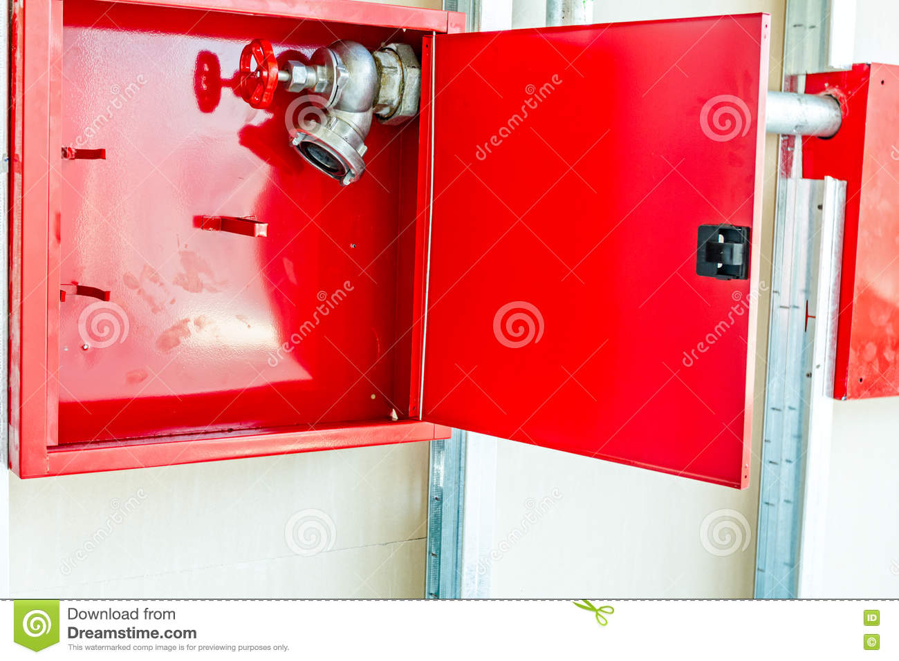 Red Box With Fire Hydrant Is Built In An Unfinished Plaster Wall ...