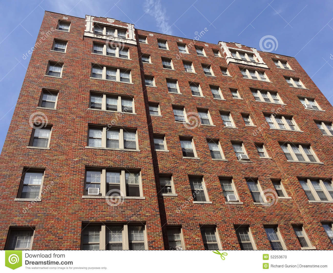 Brick Apartment Building windows on red brick apartment building stock photo - image: 55674378