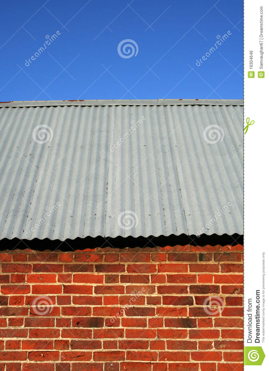 Red Brick Barn With Corrugated Iron Roof Stock Photo