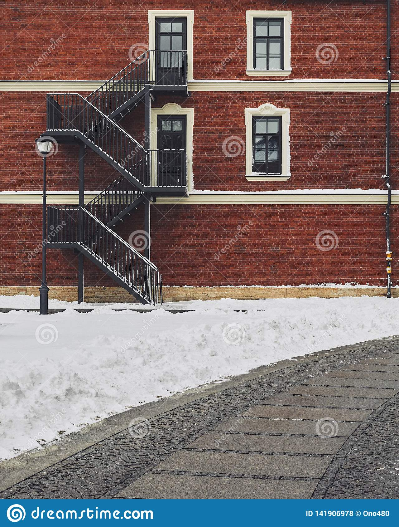 Red brick building. Staircase, the facade of the building. fire exit