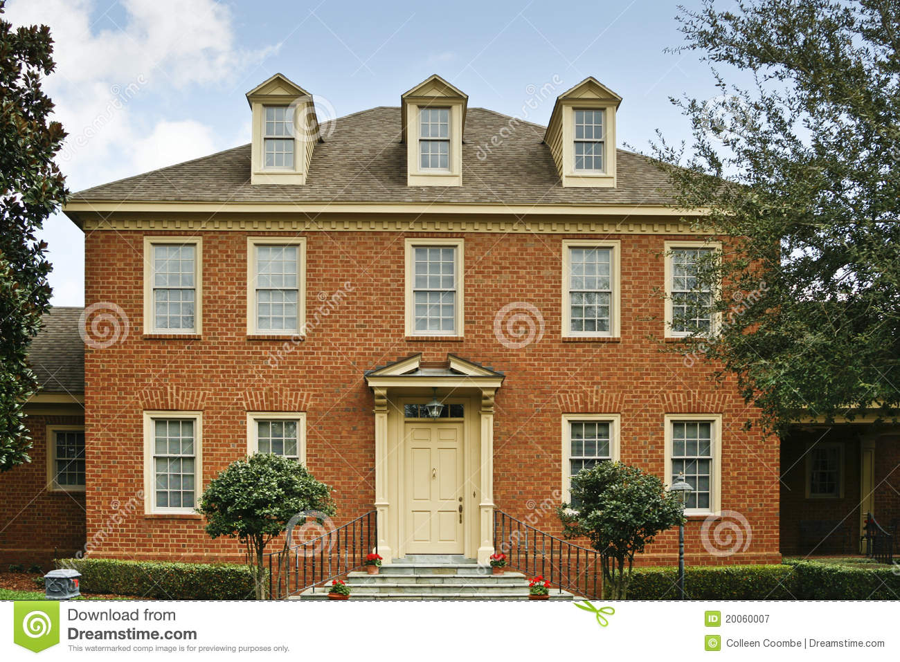 Red brick colonial style home royalty free stock for Brick style homes