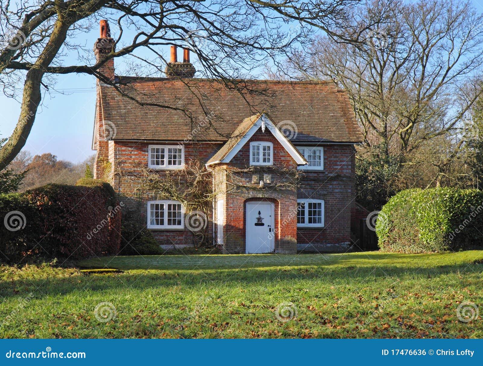 Red brick english village house garden stock photo for Red brick garden