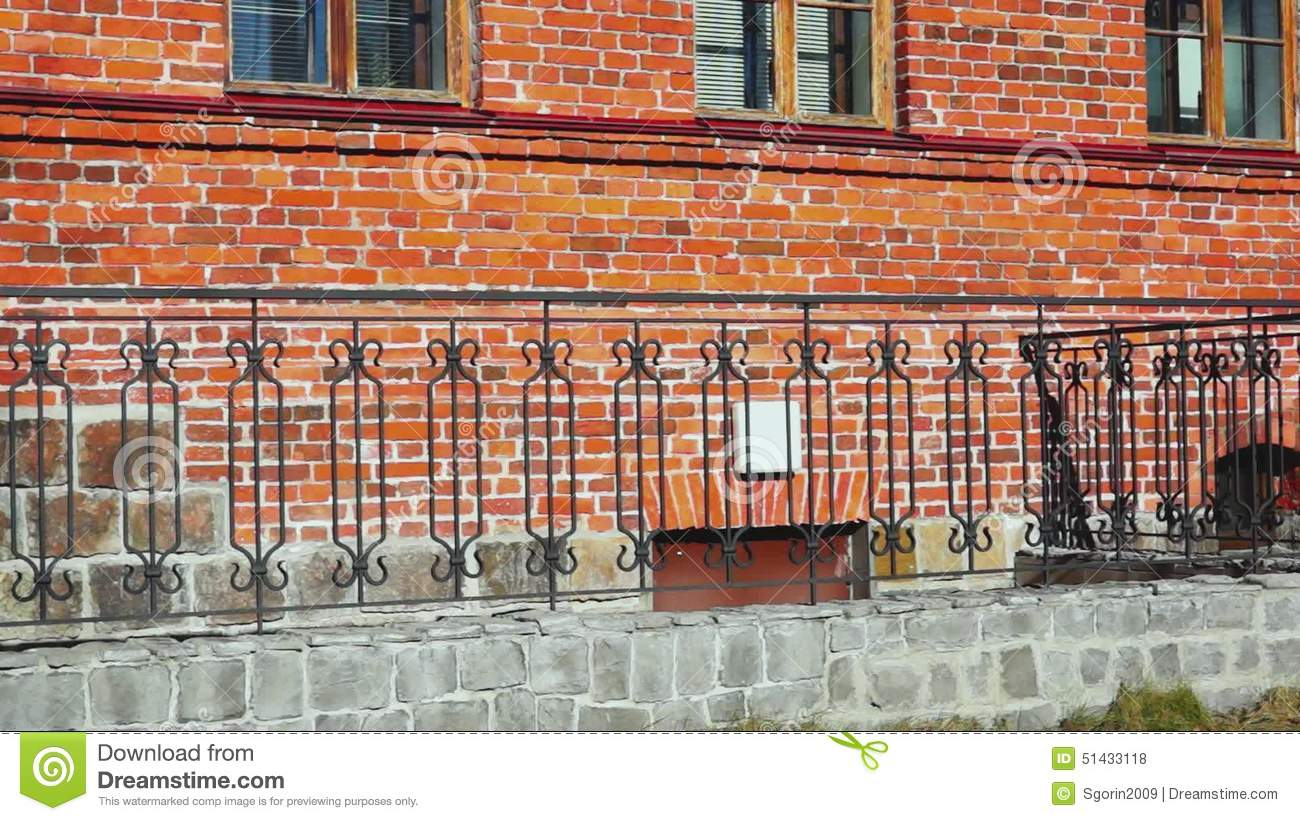 red brick house wall and decorative fence stock footage - video