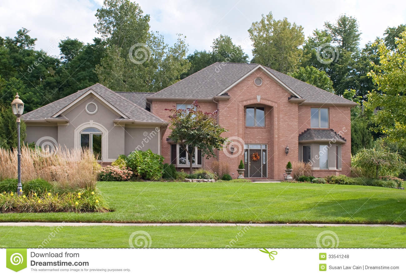 Red brick tan stucco home royalty free stock photos for Stucco and brick homes