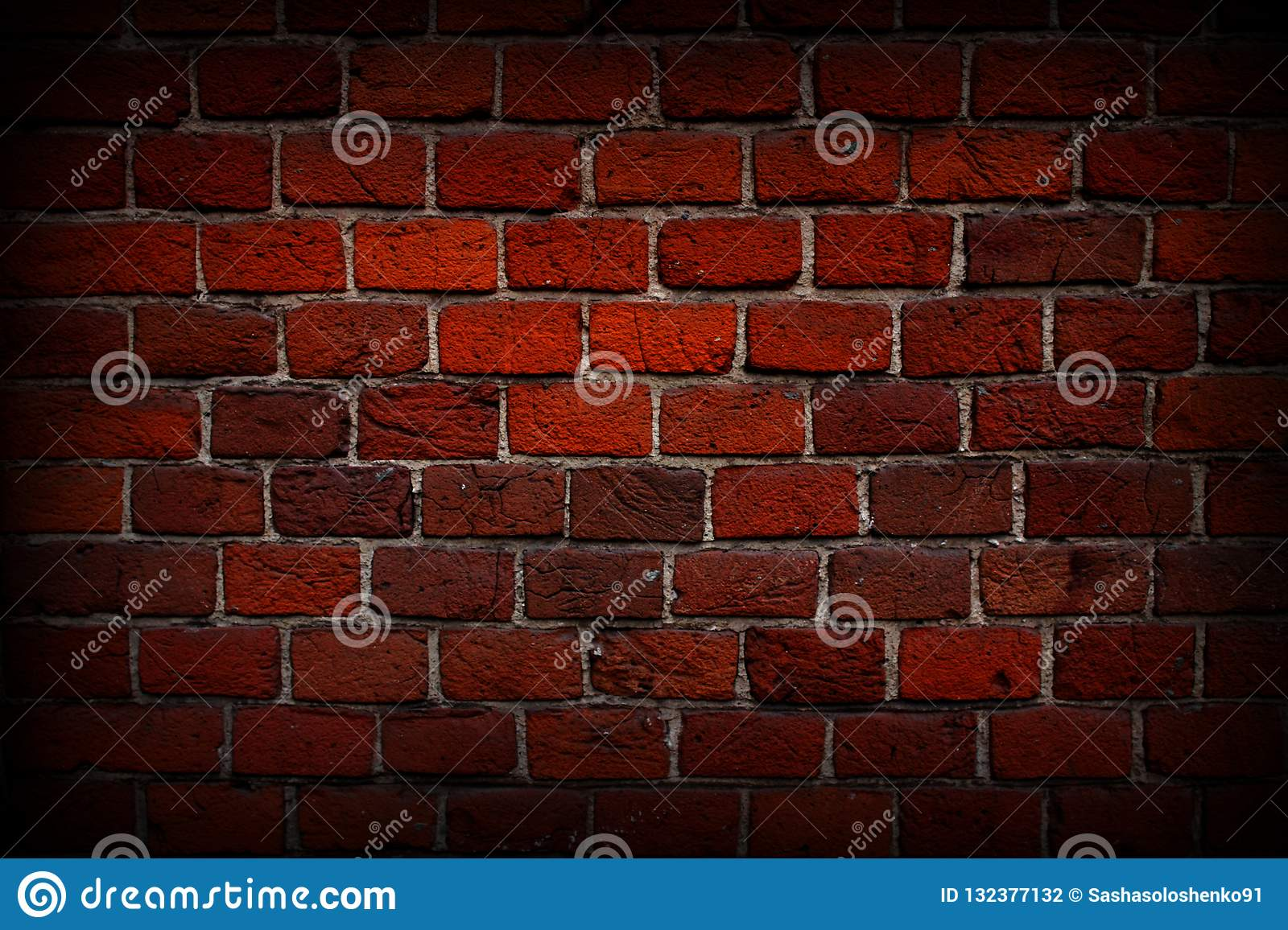 Red brick wall close-up, texture, background, grunge.