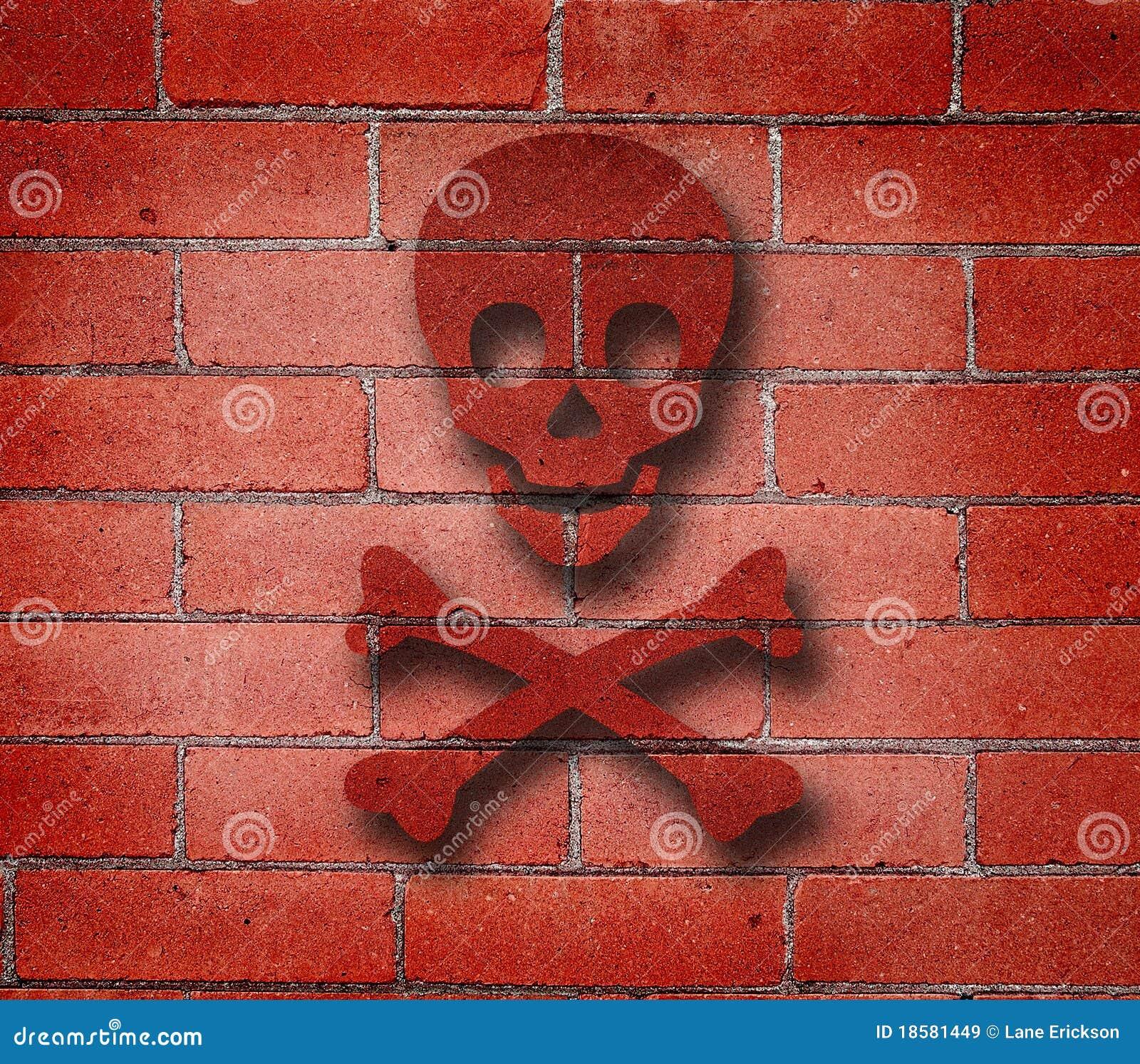 Grafiti wall red - Red Brick Wall With Cross Bones Graffiti Royalty Free Stock Images