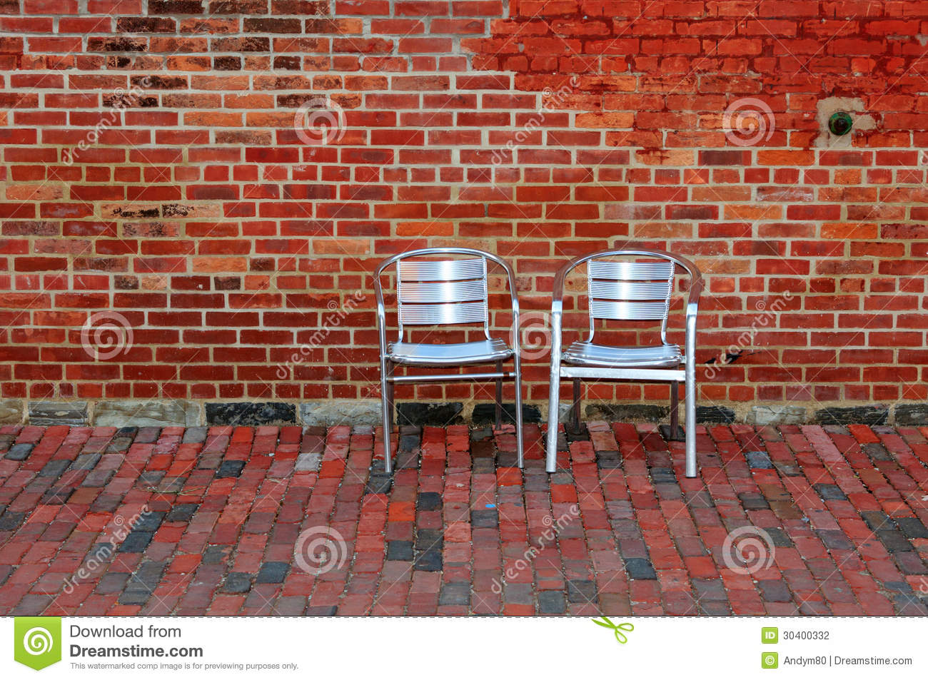 Two Chairs On Red Brick Background Stock Photo