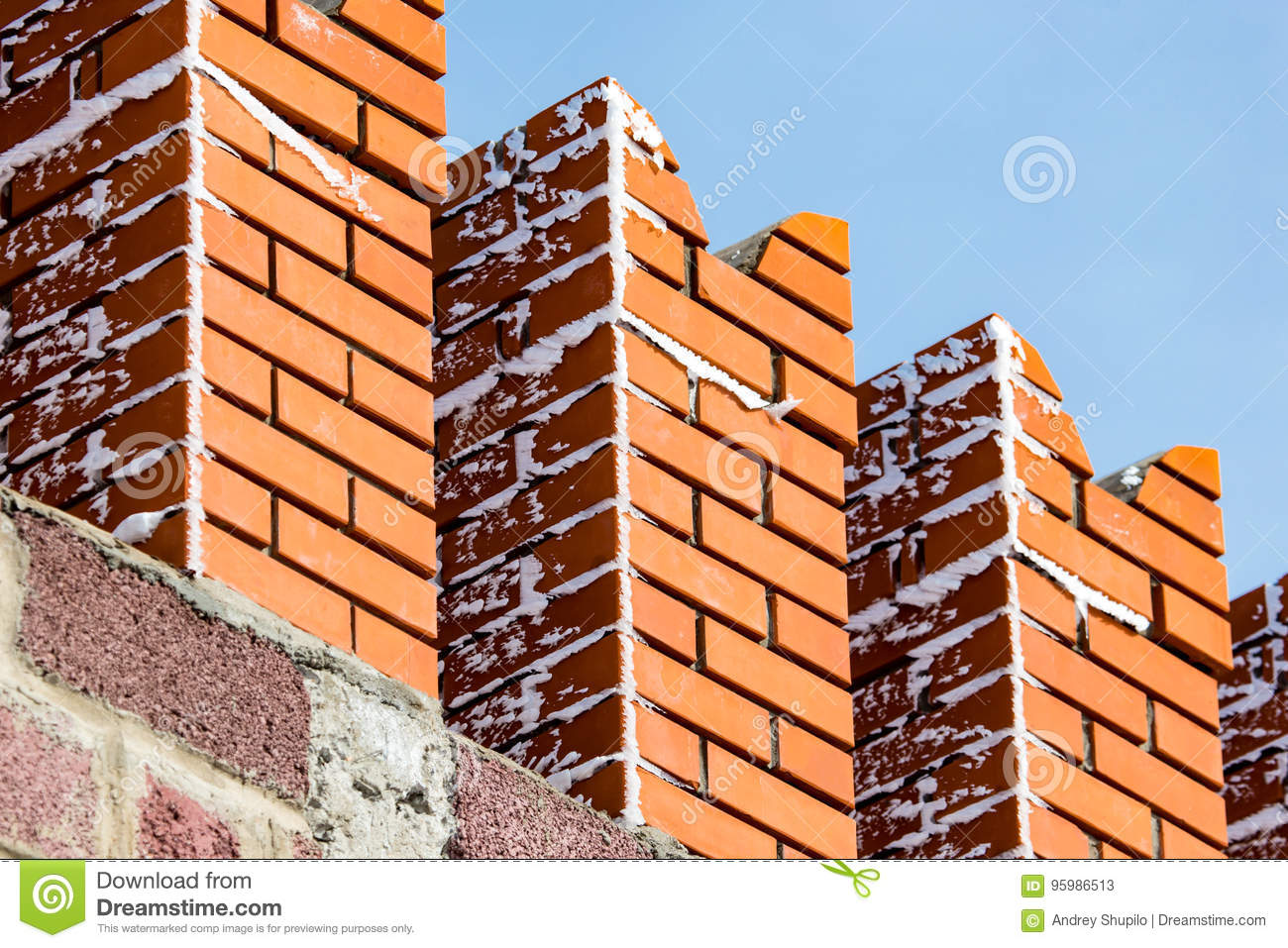 Red bricks in the wall of the Kremlin against the blue sky
