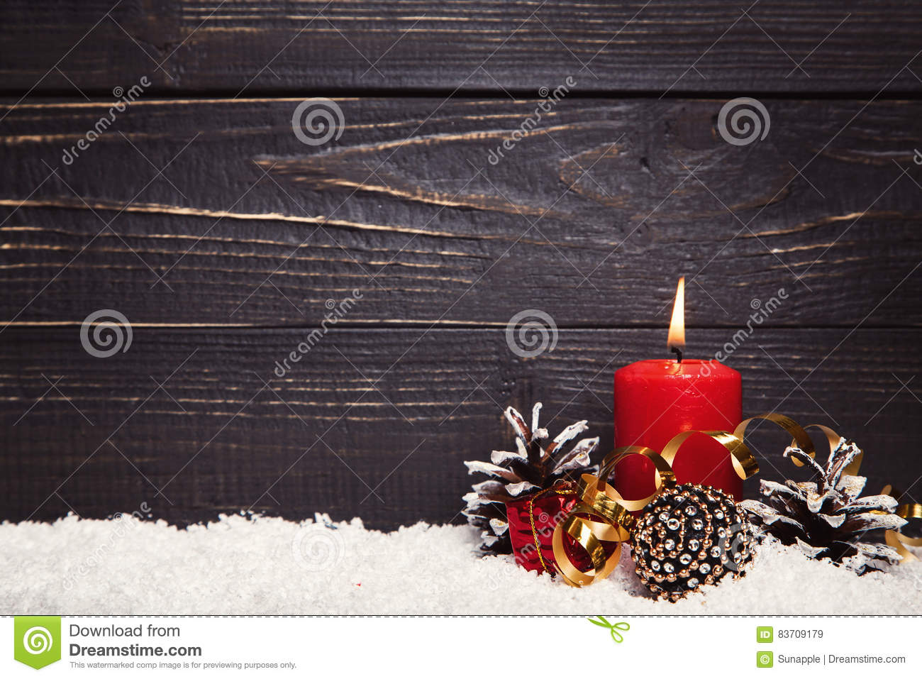 Red Burning Candle With Black Rustic Wooden Board Stock Photo