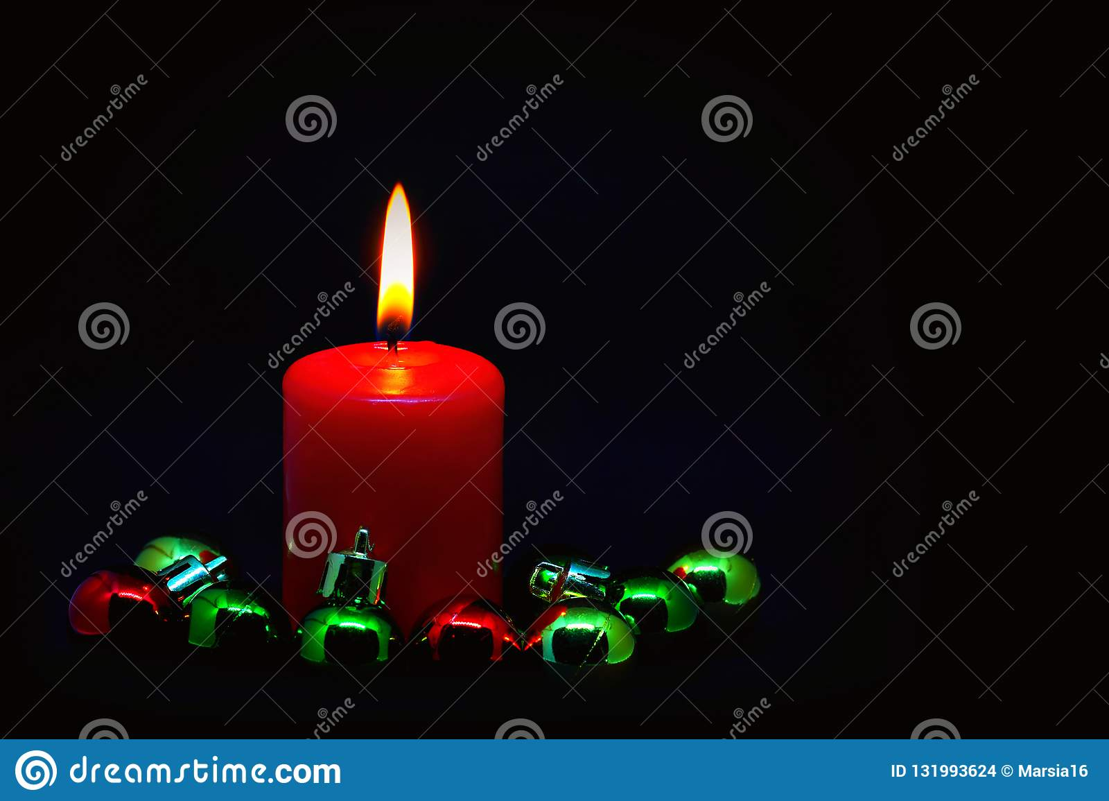 Red Candle With Colorful Small Christmas Balls