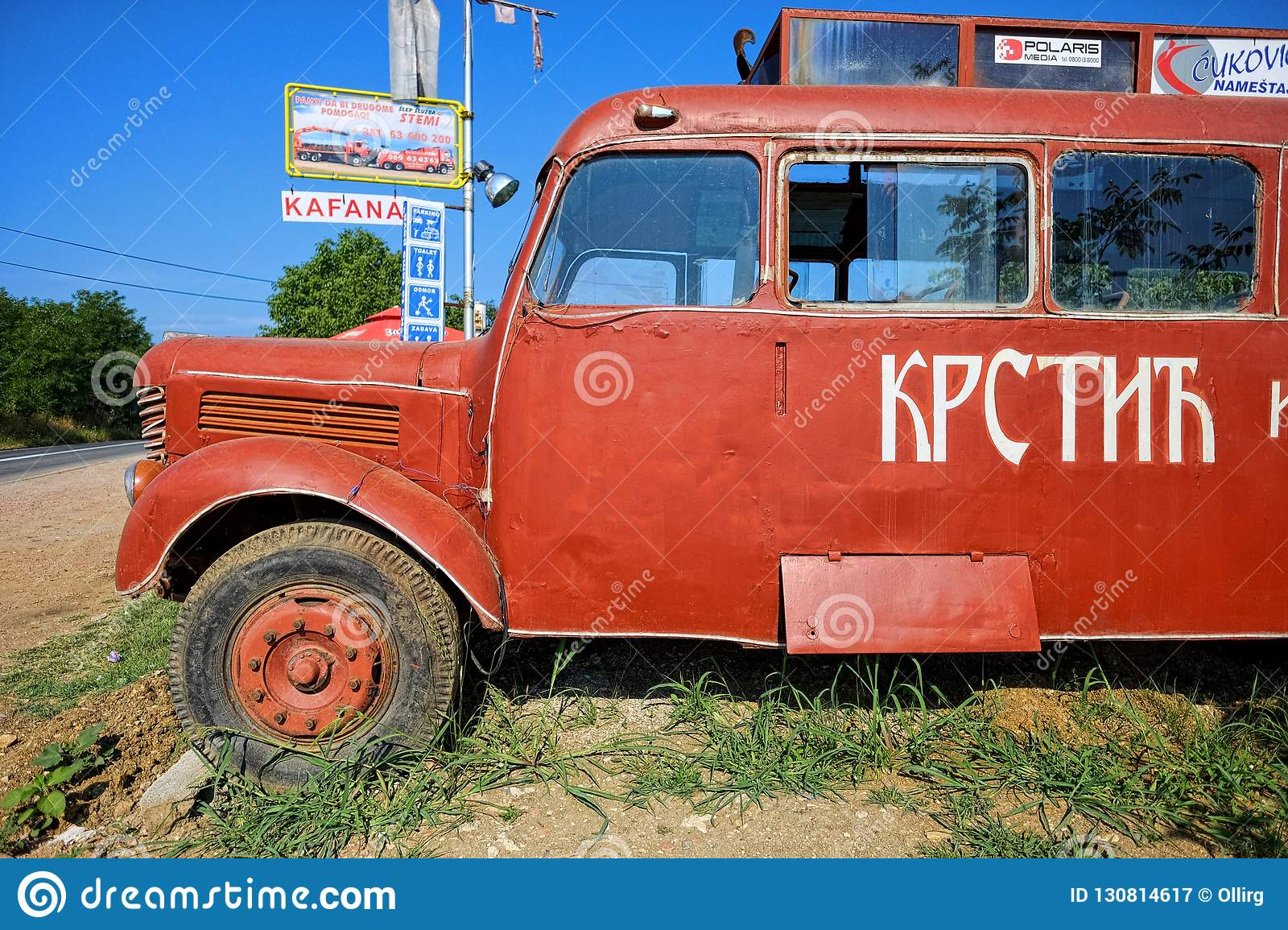 A Red Bus Similar To That Used In The Movie `Who`s Singin