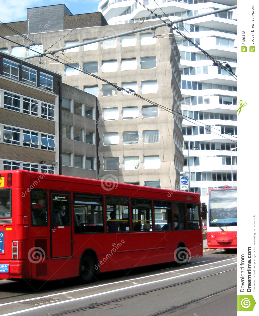 Red bus and tram line