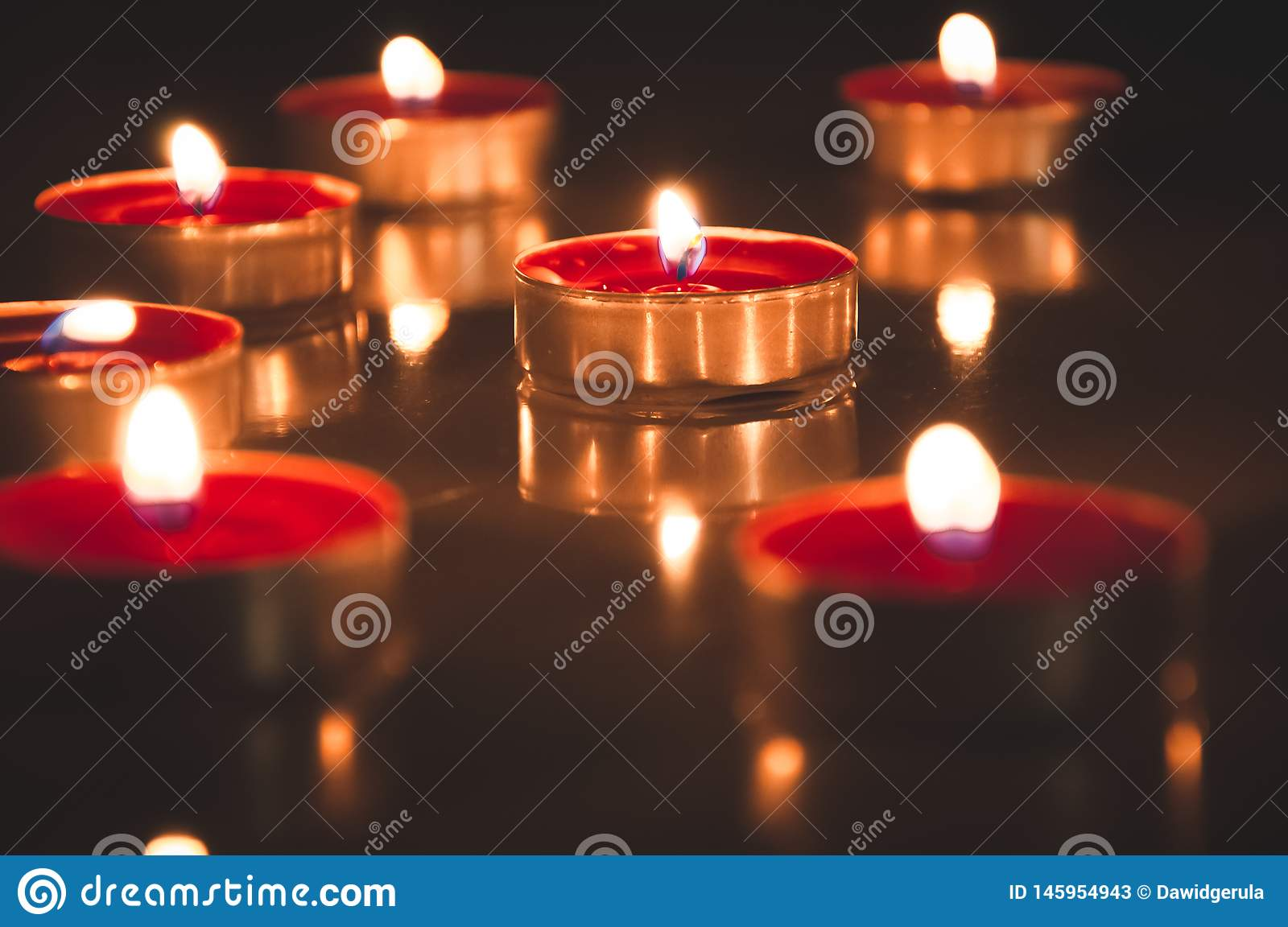 Red candles glowing in the night