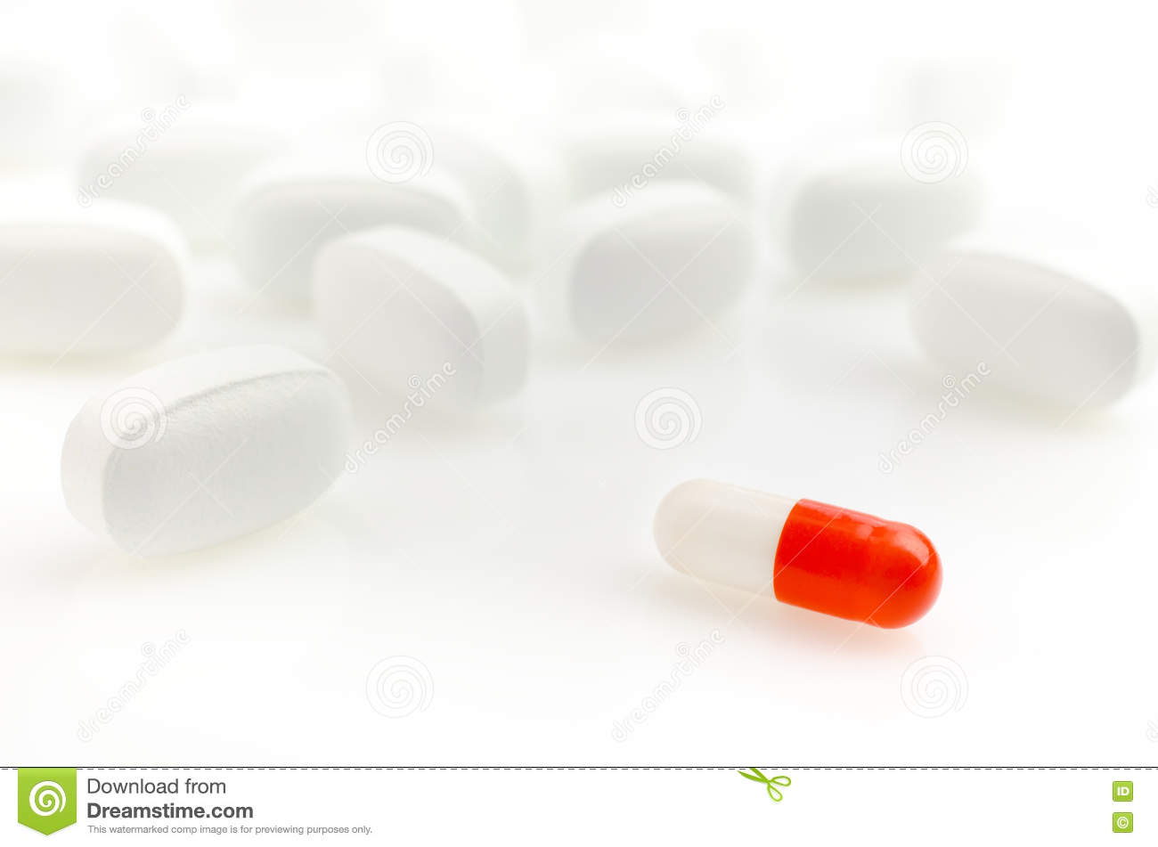 red and white capsule pills with background royaltyfree