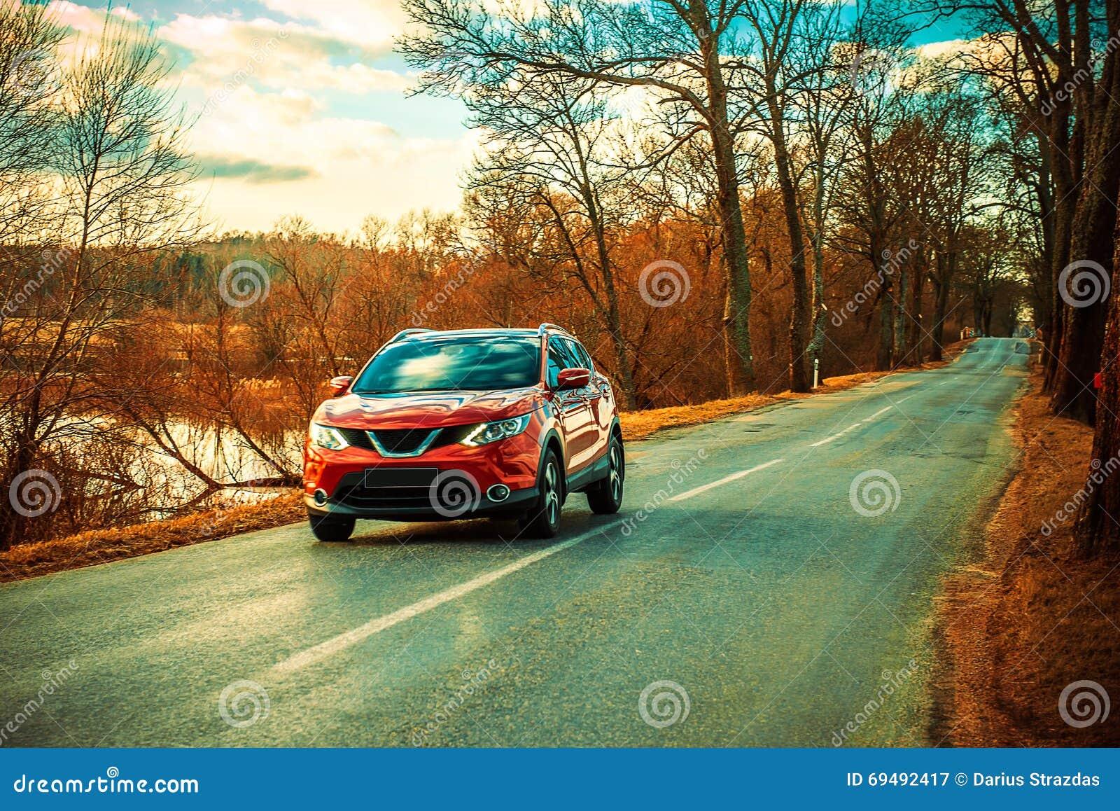Red car and Asphalt road