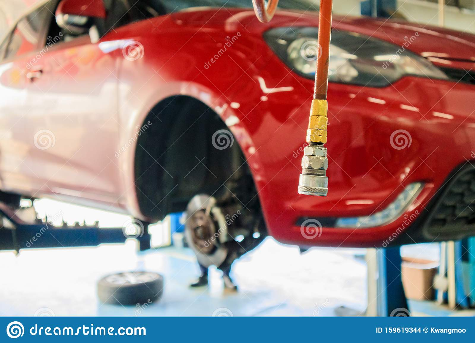 Red Car Lift At Maintenance Station In Automotive Service ...
